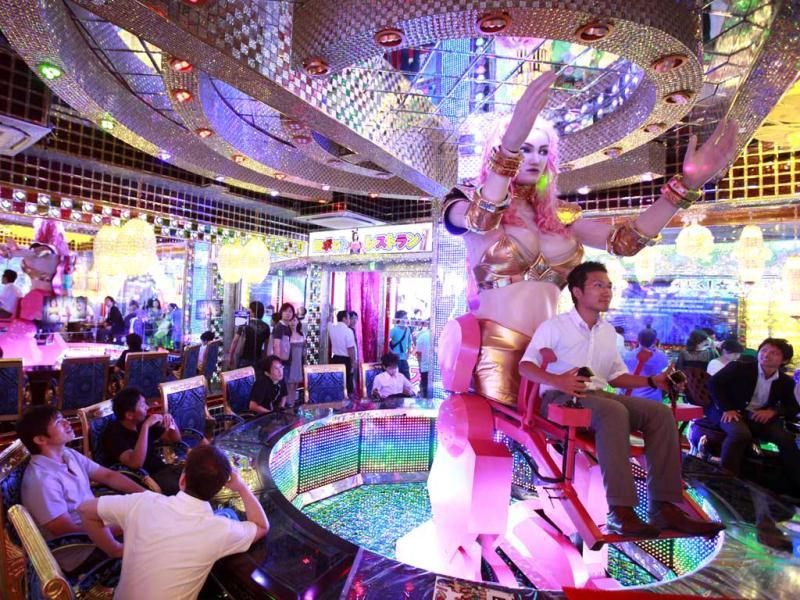 A customer is seated on a custom-made female robot at the newly opened Robot Restaurant in Kabukicho, one of Tokyo's best known red light districts. Reuters Photo