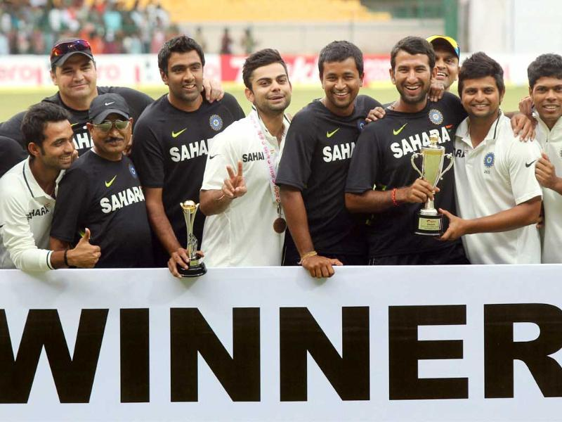 Indian team players and officials pose for photographers as they jubilate after winning the 2nd Test match to win the two test match series against New Zealand 2-0, in Bangalore. (PTI Photo by Shailendra Bhojak)