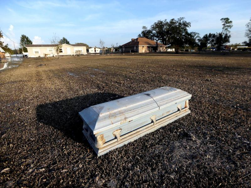 A coffin is washed up onto a front lawn due to Hurricane Isaac flooding in Plaquemines Parish in Braithwaite, Louisiana. AFP photo