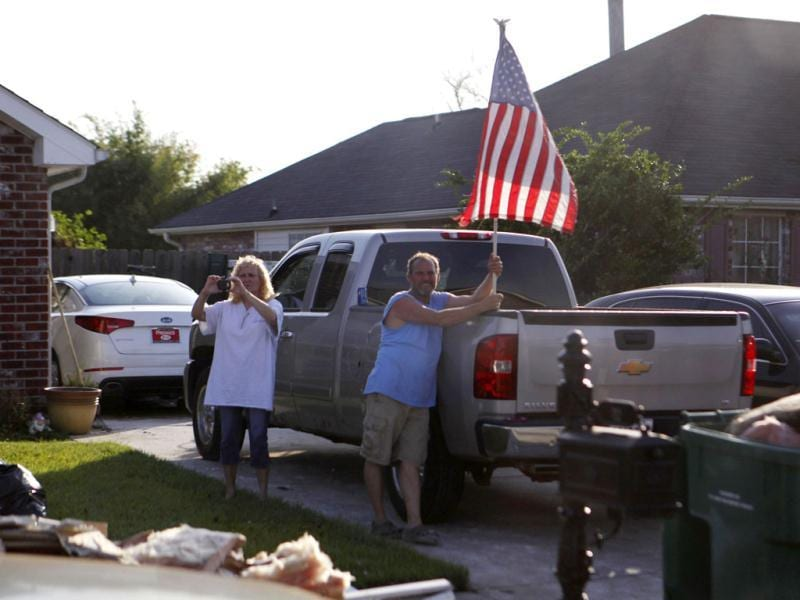 A homeowner stands with an American flag in front of his Hurricane Isaac affected house as US President Barack Obama tours the Ridgewood neighbourhood of LaPlace, Saint John the Baptist Parish in Louisiana. Reuters photo
