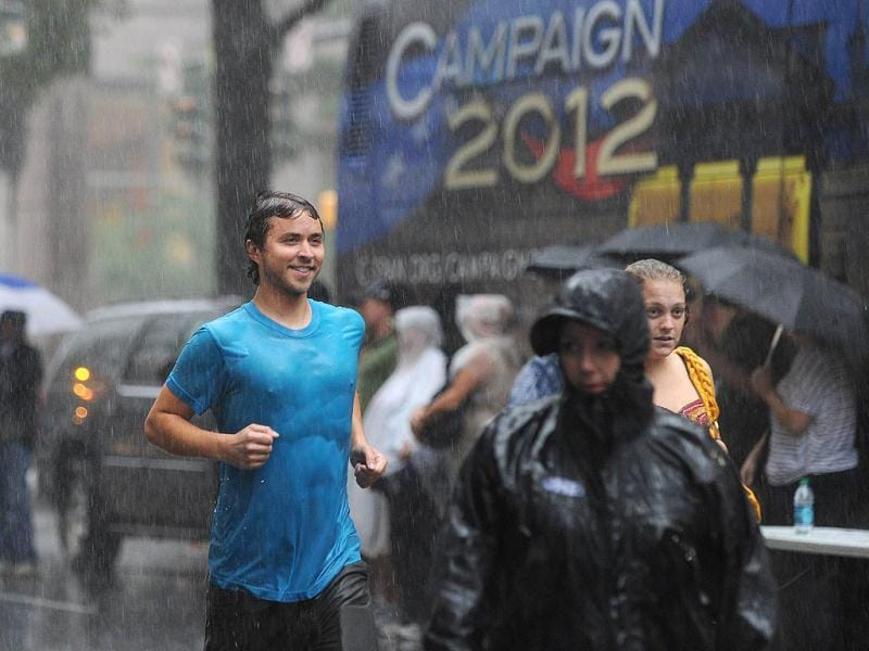 A man jogs in the heavy rain of a thunderstorm at the Carolina Fest street fair, on the eve of the Democratic National Convention (DNC) in Charlotte, North Carolina. AFP photo
