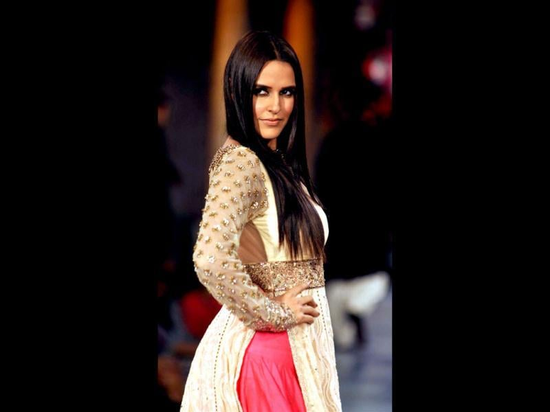 Neha Dhupia also walks the ramp at the fashion show for The Mijwan Welfare Society. (Photo: AFP)