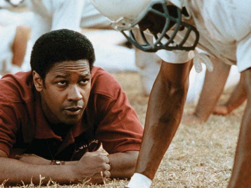 Remember The Titans is probably both the best football movie and a great teacher movie. This true life story of two segregated schools learning how to deal with the issues that faced them in 1970. These two coaches taught their players and each other more than just how to win a game. Denzel Washington starred in this.