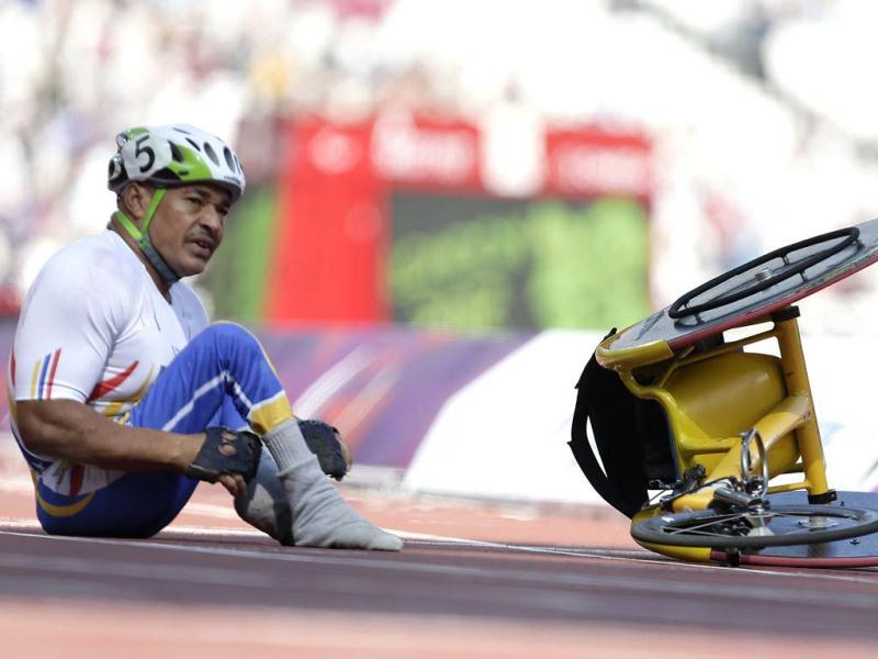 Jesus Aguilar of Venezuela looks down the track after he crashed out of a men's 80-meter at the 2012 Paralympics games in London.(AP Photo/Alastair Grant)