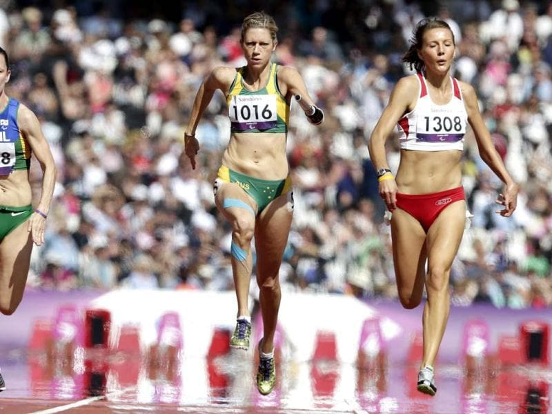 Carlee Beattie of Australia, competes with Sheila Finder of Brazil, and Katarzna Piekart of Poland in a women's 100-meter T46 heat at the 2012 Paralympics games in London. (AP Photo/Alastair Grant)