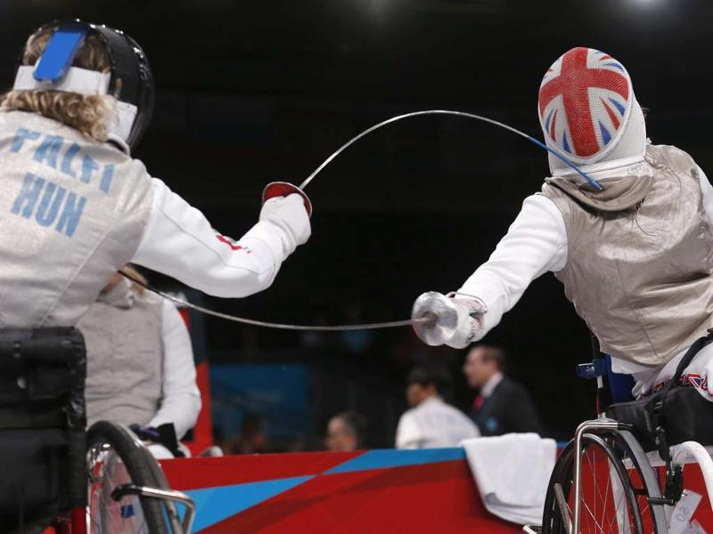 Britain's Justine Moore and Judit Palfi of Hungary compete in the qualification round of Women's Individual Foil- Category B on the first day of Fencing at the London 2012 Paralympic Games. (Reuters/Suzanne Plunkett)
