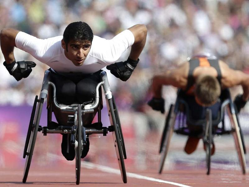 Mohamed Hammandi of the UAE competes in the men's 200-meter T34 heat at the 2012 Paralympics games in London. (AP Photo/Alastair Grant)