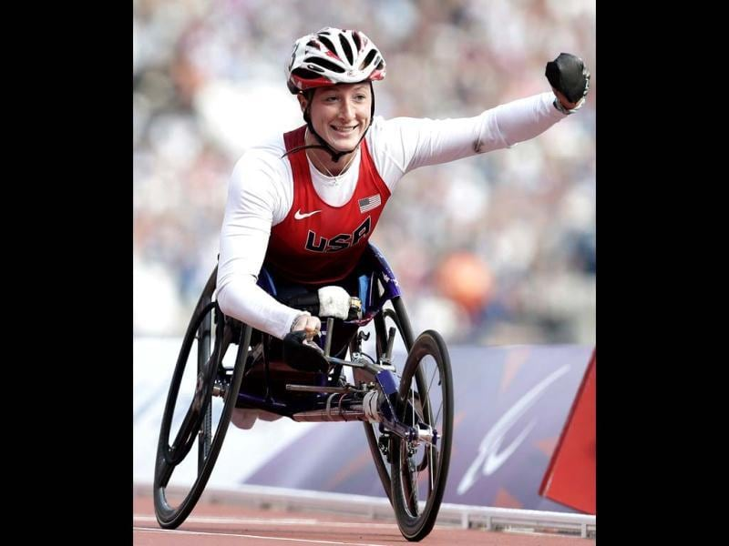 Tatyana McFadden of the United States with celebrates after winning her heat of the women's 800-meter T54 heat at the 2012 Paralympics games in London. (AP Photo/Alastair Grant)