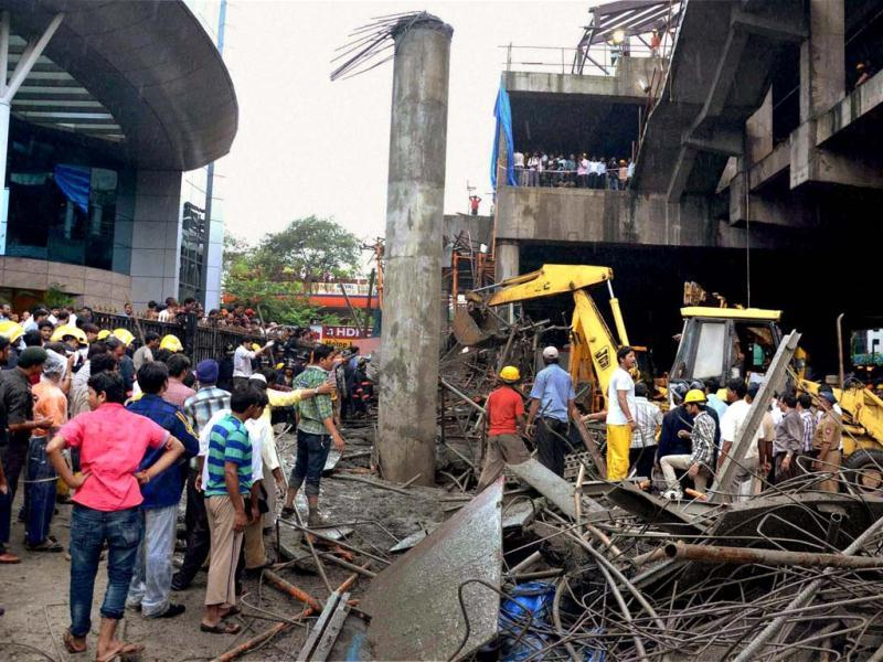 Rescue work in process after a portion of the metro rail project collapsed on the Andheri-Kurla road in Mumbai. PTI Photo