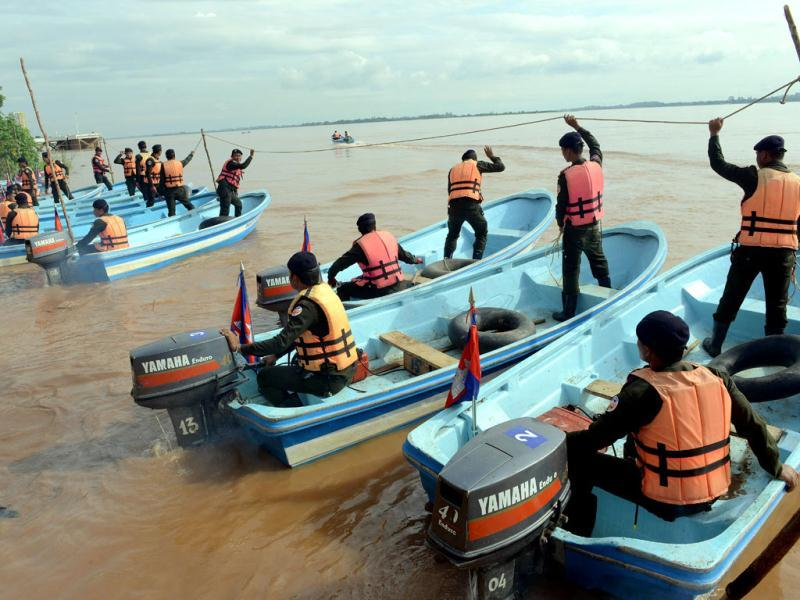 Members of a Cambodian rescue team stand on speed boats during a flood drill in Phnom Penh. Cambodia's worst floods in over a decade killed nearly 250 people last year. (AFP Photo)