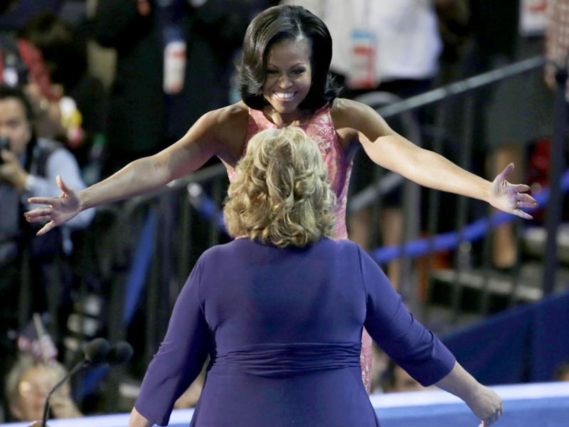 First lady Michelle Obama hugs Elaine Brye before speaking at the Democratic National Convention in Charlotte, North Carolina. AP/Lynne Sladky