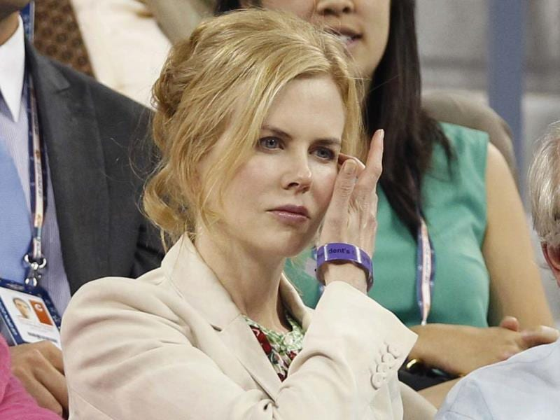 Actress Nicole Kidman watches from the crowd as Andy Roddick plays against Bernard Tomic of Australia at the US Open tennis tournament in New York. (Reuters/Adam Hunger)