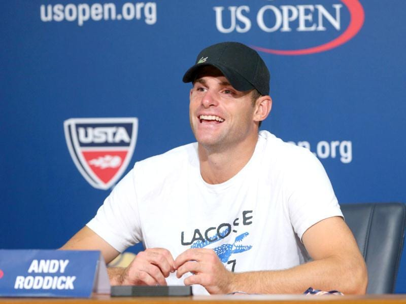 Andy Roddick of the US smiles during a post match press conference following his men's singles fourth round match against Juan Martin Del Potro of Argentina. Roddick has retired from international Tennis. (AFP Photo)