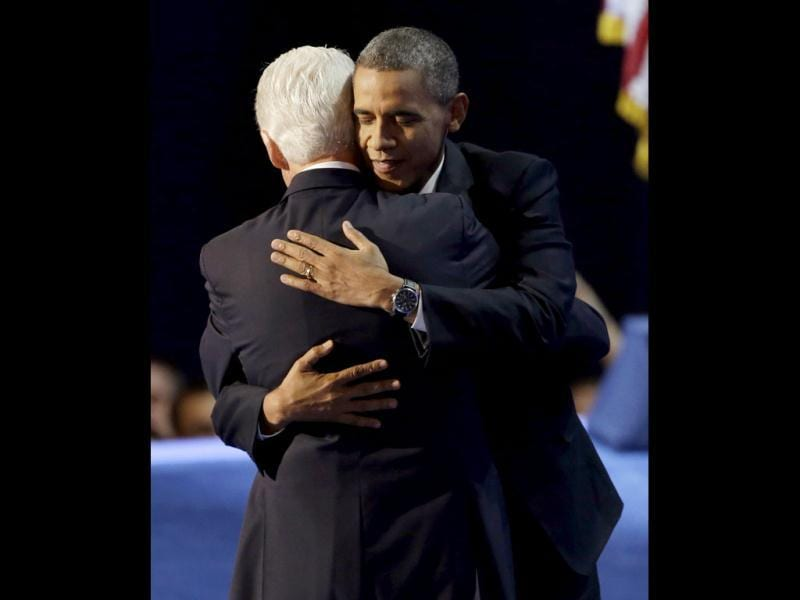 US President Barack Obama hugs former president Bill Clinton after Clintons' address to the Democratic National Convention in Charlotte, NC. (AP Photo)