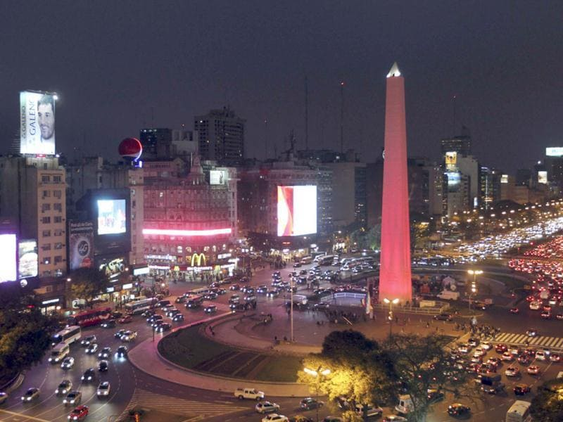 The Obelisk is lighted up in red, as part of a campaign to raise awareness in cardiovascular diseases driven by the City's government, in the city of Buenos Aires. (Reuters)