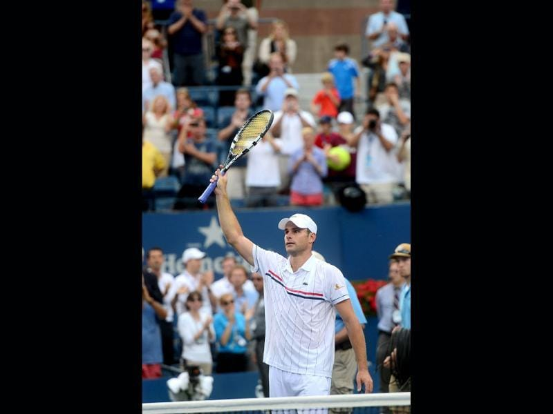 Andy Roddick acknowledges the crowd at the end of his match against Juan Martin Del Potro at the 2012 US Open men's singles match at the USTA Billie Jean King National Tennis Center in New York. AFP/Emmanuel Dunand