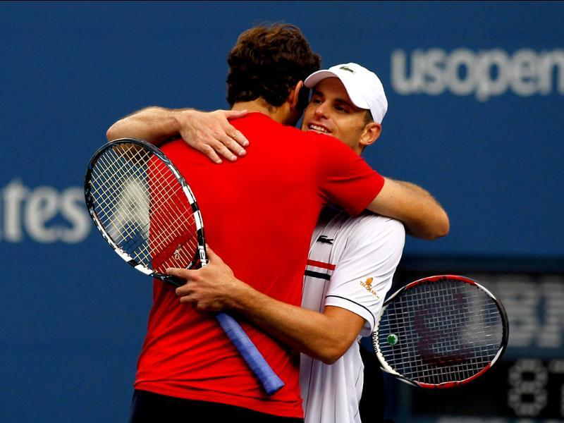 Juan Martin Del Potro of Argentina is congratulated by Andy Roddick of the United States after defeating him during their men's singles fourth round match on day ten of the 2012 US Open at the USTA Billie Jean King National Tennis Center. Mike Stobe/Getty Images/AFP