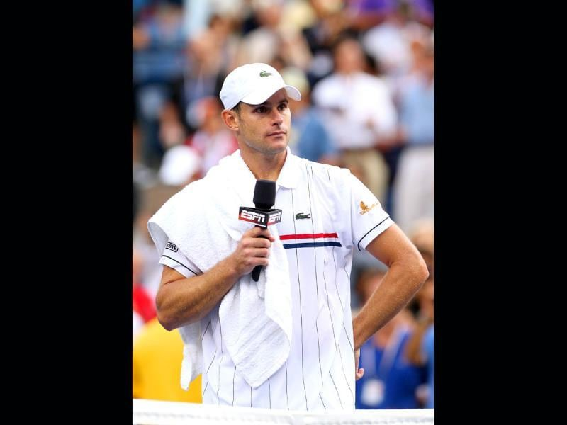 Andy Roddick of the United States speaks to the crowd after losing to Juan Martin Del Potro of Argentina after their men's singles fourth round match on day ten of the 2012 US Open at USTA Billie Jean King National Tennis Center. Cameron Spencer/Getty Images/AFP