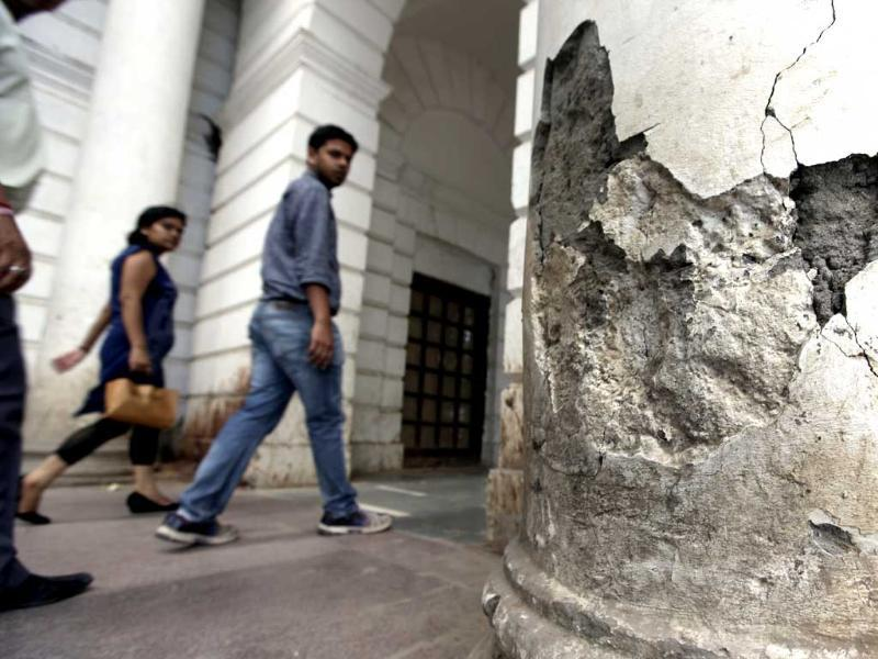Poportions of the walls have chipped off at many places in Block-A, Connaught Place. The project to take the British era market back to its glory days has missed every deadline. HT Photo/Raj K Raj