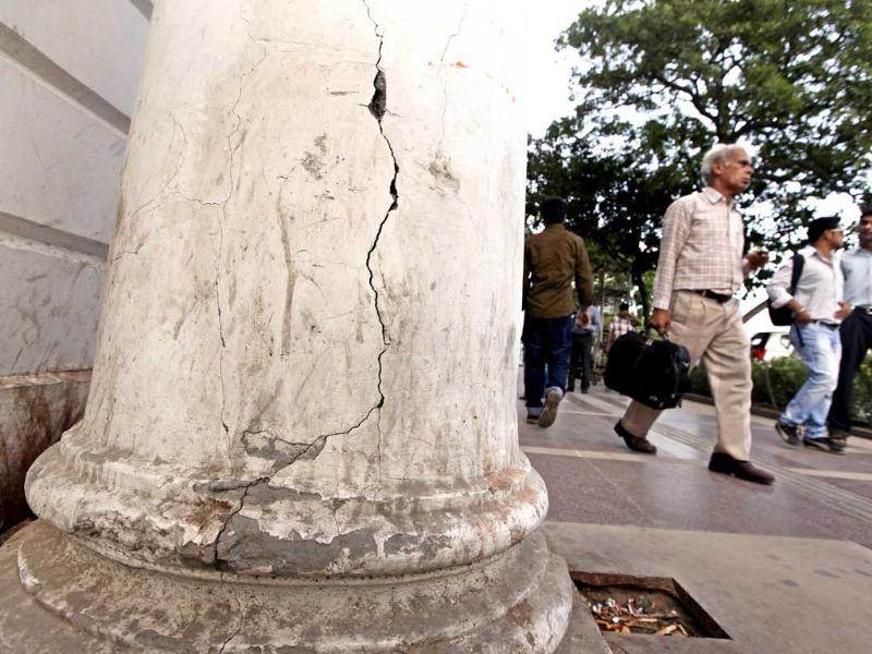 Cracks are visible on a pillar in Block-A, Connaught Place. The project to take the British era market back to its glory days has missed every deadline. HT Photo/Raj K Raj