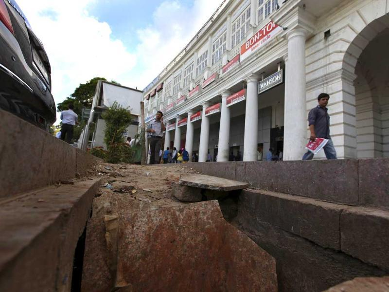 A dug-up road is seen in Block-A, Connaught Place. For the fourth year in a row, Connaught Place will miss the Diwali shopping blitz because of haywire construction, dug-up roads, waterlogged corridors and nightmare parking. HT Photo/Raj K Raj