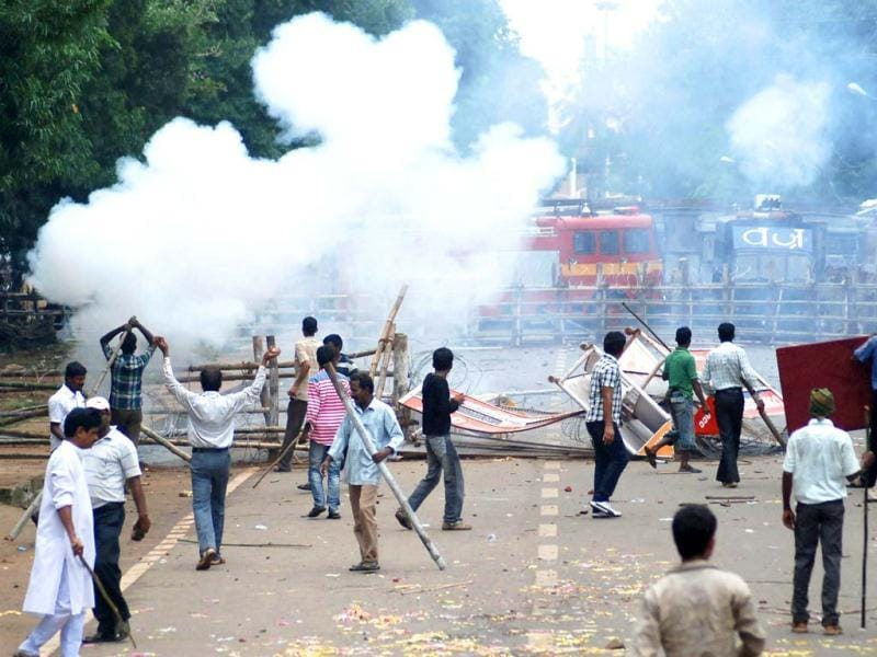 Police fire teargas during a violent protest in Bhubaneswar. (AFP photo)