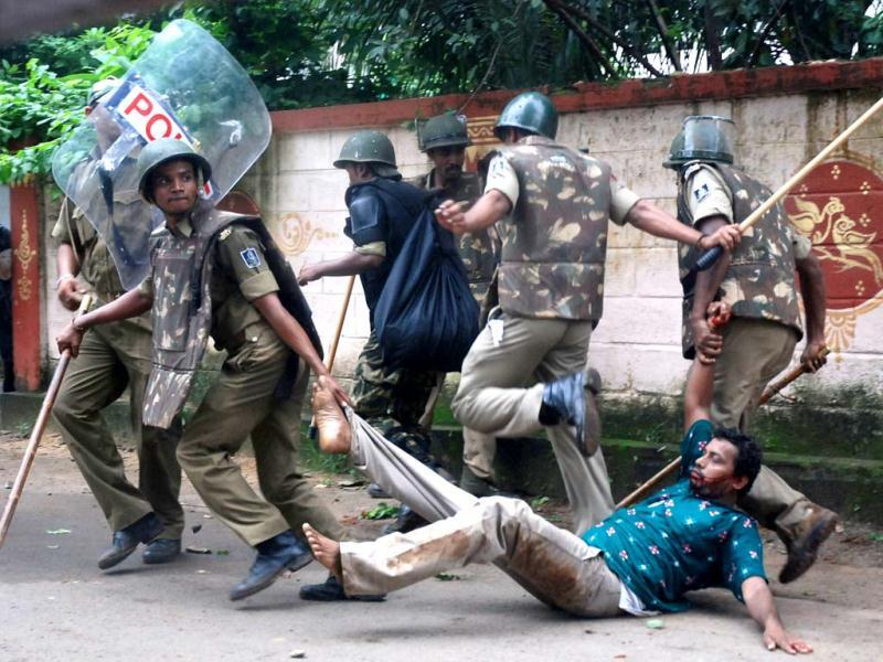 A demonstrator is taken away by policemen during a violent protest in Bhubaneswar. (AFP photo)