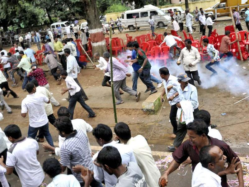 Congress workers during a clash with the police after a protest over coal blocks allocation in Bhubaneswar. (PTI photo)