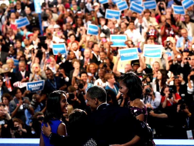 Democratic presidential candidate, US President Barack Obama stands on stage after accepting the nomination with his family, Sasha Obama, first lady Michelle Obama, and Malia Obama during the final day of the Democratic National Convention at Time Warner Cable Arena. Win McNamee/AFP