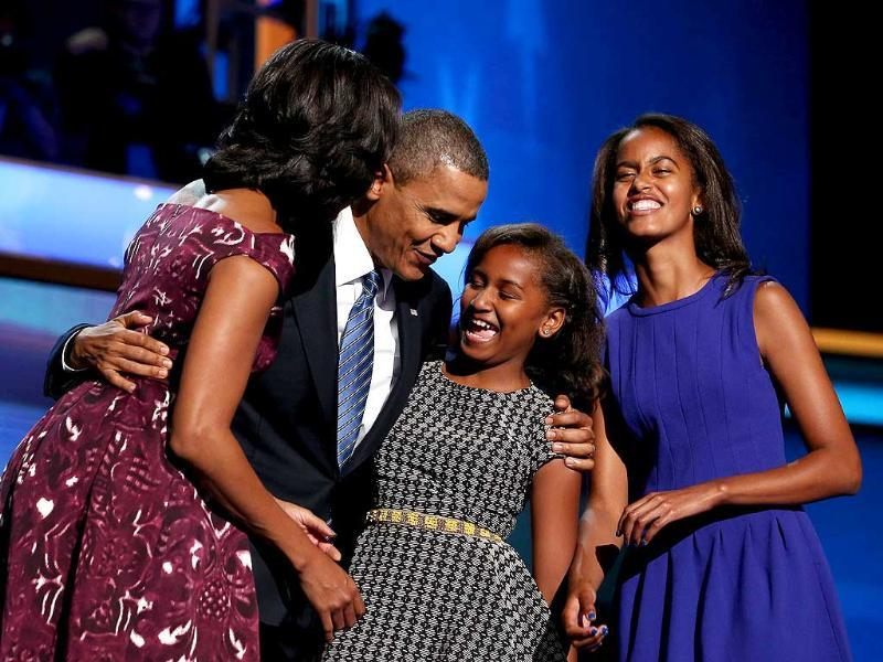 Democratic presidential candidate, US President Barack Obama stands on stage after accepting the nomination with his family, first lady Michelle Obama, Sasha Obama, and Malia Obama during the final day of the Democratic National Convention at Time Warner Cable Arena in Charlotte, North Carolina. Chip Somodevilla/AFP