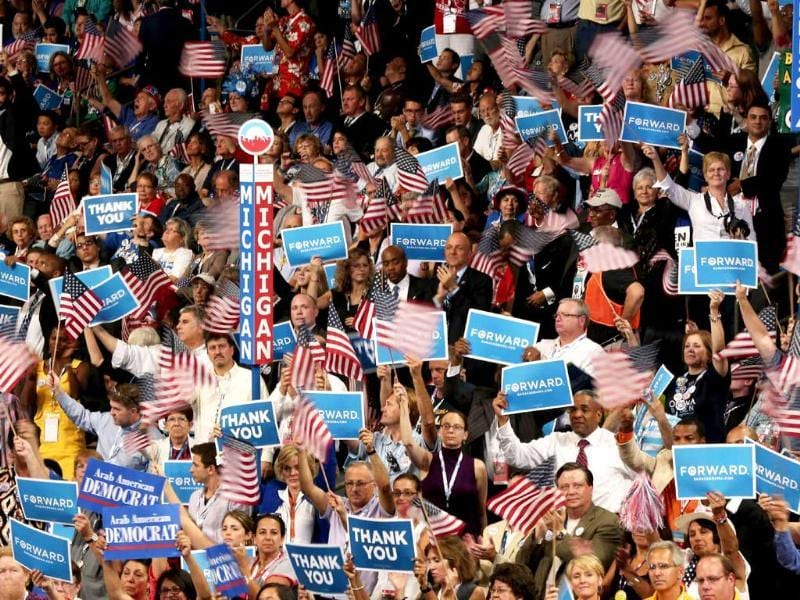 People cheer as Democratic presidential candidate, US President Barack Obama speaks on stage as he accepts the nomination for president during the final day of the Democratic National Convention at Time Warner Cable Arena in Charlotte, North Carolina. Win McNamee/AFP