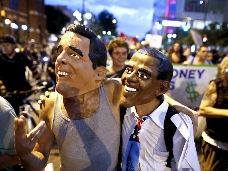 Demonstrators wear masks of US Republican presidential candidate Mitt Romney and US President Barack Obama at a march during the final day of the Democratic National Convention in Charlotte, North Carolina. Reuters/John Adkisson