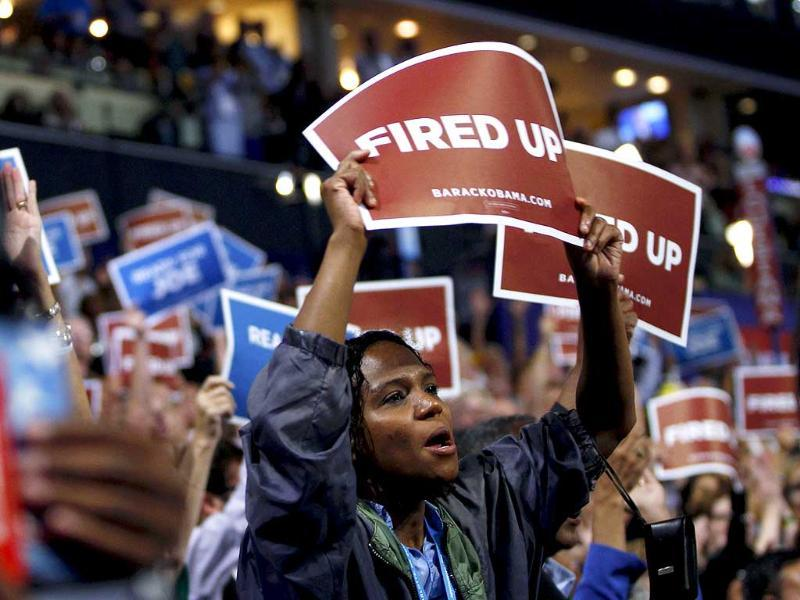 Delegates hold a signs during the final session of the Democratic National Convention in Charlotte, North Carolina. Reuters/Jessica Rinaldi