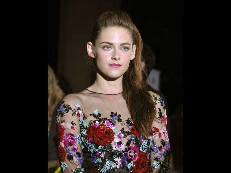 Kristen looked pale and listless in contrast with her brightly hued dress.