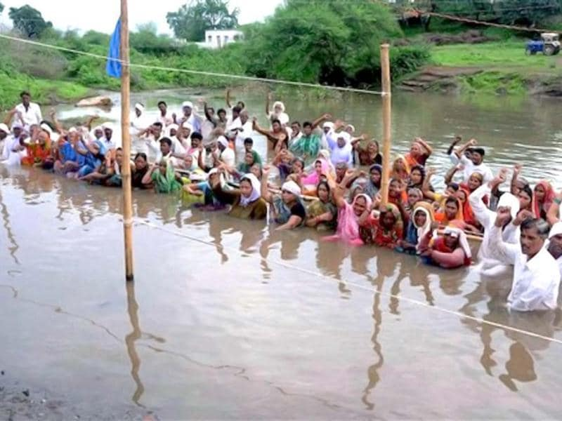 Omkarsershwar dam affected people continuously standing in the back water of Narmada river during 'Jal Staygrah' for rehabilitation, organised by Narmada Bachao Andolan activists at village Gogalgaon in Khandwa district in Madhya Pradesh.