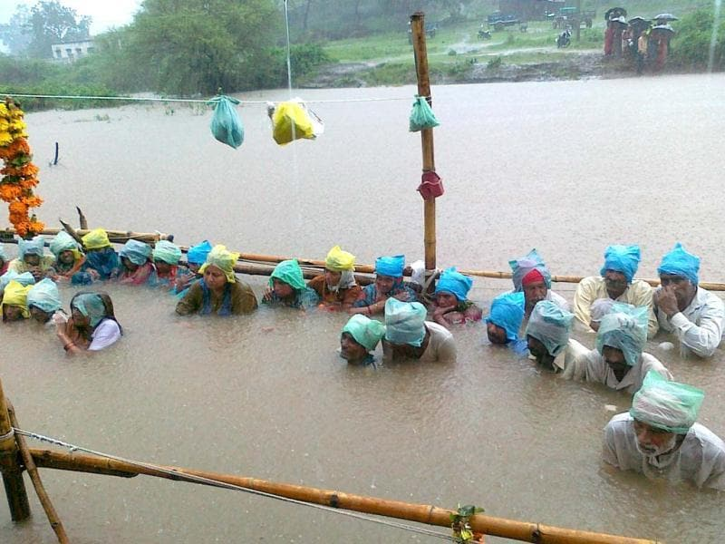 Omkareshwar dam affected people continue their protest standing in neck-deep water in the Narmada river for the 11th day at Gopalgaon in Khandwa district of Madhya Pradesh. Agencies