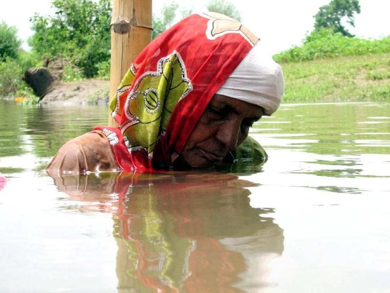 A protestor manages to catch up with some sleep while standing in neck-deep water for the 11th day of agitation against the Omkareshwar dam in the Narmada, at Gopalgaon in Khandwa district of Madhya Pradesh. Agencies