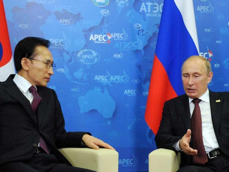 Russian President Vladimir Putin, right, gestures as he talks with South Korean President Lee Myung-bak during a bilateral meeting at the APEC summit in Vladivostok, Russia. (AP Photo)