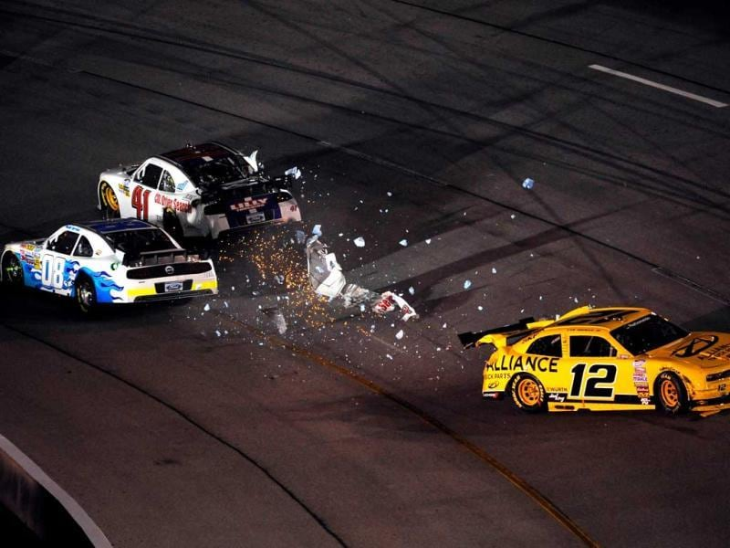 Paulie Harraka, Timmy Hill and Sam Hornish Jr are involved in a wreck during the NASCAR Nationwide Series Virginia 529 College Savings 250 at Richmond International Raceway, Virginia. (AFP Photo)
