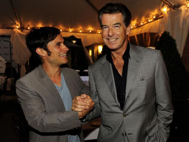 Mexican actor Gael Garcia Bernal mingles with actor Pierce Brosnan at the Sony Pictures Classics party at the 2012 Toronto Film Festival. AP/Chris Pizzello