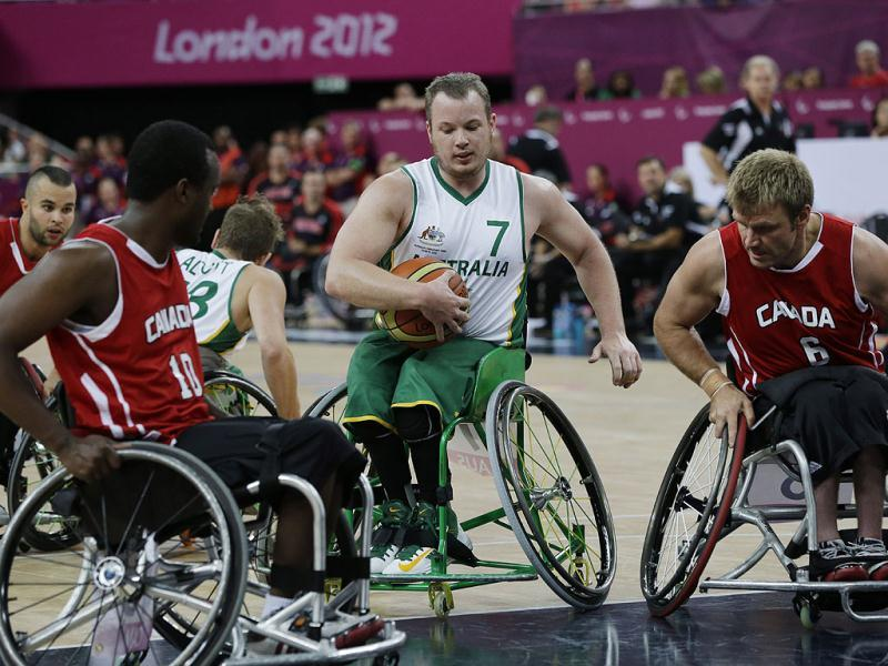 Australia's Shaun Norris dribbles the ball during the men's wheelchair basketball final game against Canada at the 2012 Paralympics in London. Canada won the game 64-58 and the gold medal. AP/Lefteris Pitarakis