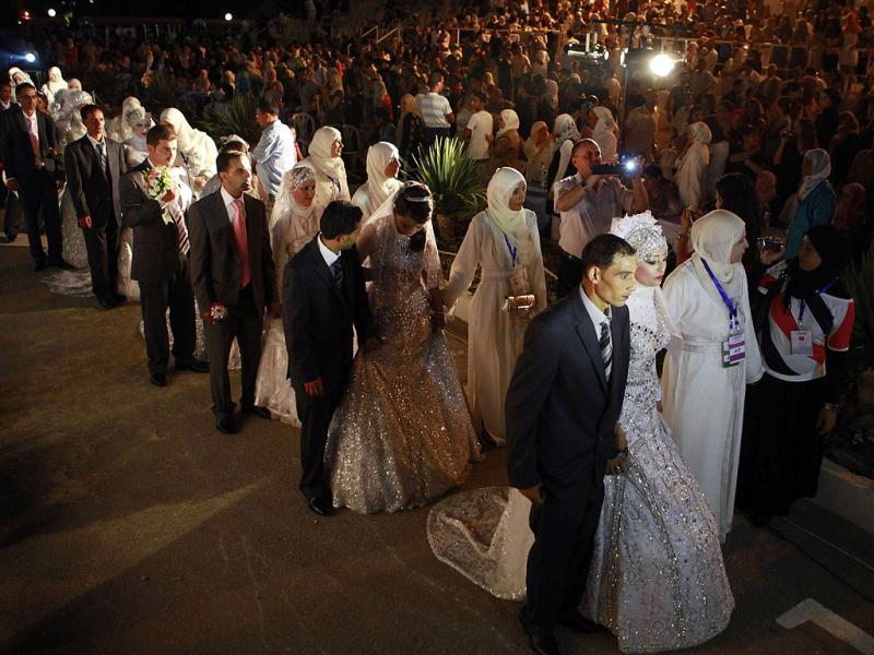 People attend a mass wedding in Tunis. The event, where 26 couples were married, was organised and sponsored by AFEF to encourage more couples to get married. Reuters/Zoubeir Souissi