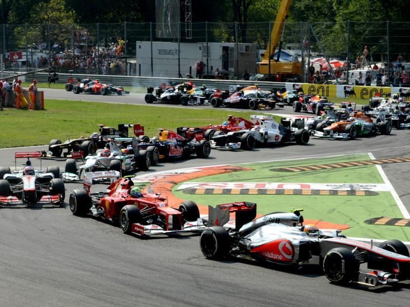 McLaren Mercedes' British driver Lewis Hamilton leads followed by Ferrari's Brazilian driver Felipe Massa and McLaren Mercedes' British driver Jenson Button at the Autodromo Nazionale circuit in Monza during the Formula One Italian Grand Prix. AFP Photo/Dimitar Dilkoff