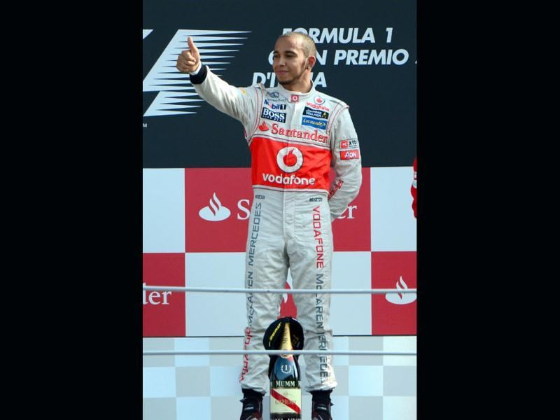 McLaren Mercedes' British driver Lewis Hamilton celebrates on the podium at the Autodromo Nazionale circuit in Monza after the Italian Formula One Grand Prix. AFP Photo/Olivier Morin