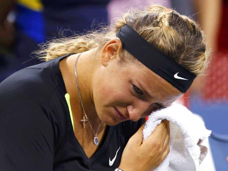 Victoria Azarenka of Belarus reacts after her defeat to Serena Williams of the US in their women's singles finals match at the US Open tennis tournament in New York. (Reuters/Kevin Lamarque)