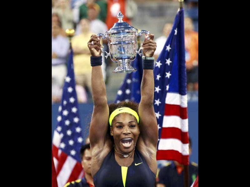 Serena Williams of the US celebrates with her trophy after defeating Victoria Azarenka of Belarus in their women's singles finals match at the US Open tennis tournament in New York. REUTERS