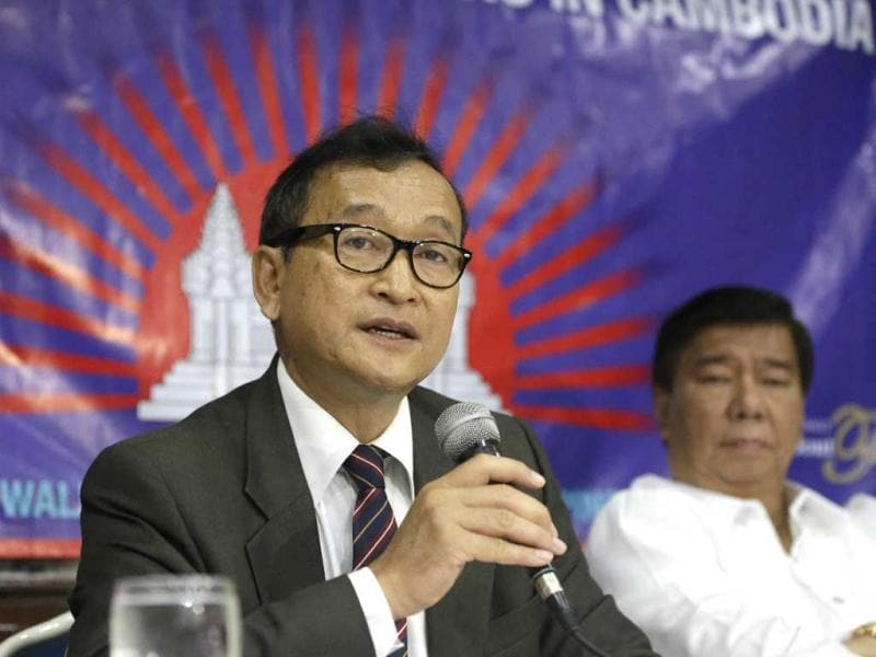 Cambodian opposition leader Sam Rainsy, left, who is currently living in exile in France, talks about the opposition's plans for next year's elections in Cambodia during the launching of the International Parliamentary Committee for Democratic Elections in Cambodia with Philippine Sen. Franklin Drilon. (AP Photo/Bullit Marquez)