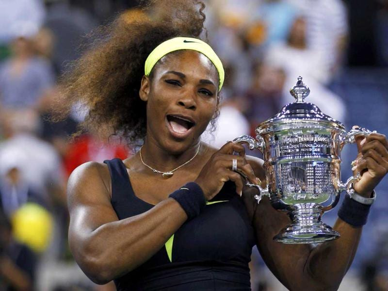Serena Williams of the US poses with her trophy after defeating Victoria Azarenka of Belarus in their women's singles finals match at the US Open tennis tournament in New York. (Reuters/Adam Hunger)