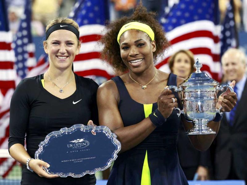 Victoria Azarenka of Belarus and Serena Williams of the US pose with their trophies after their women's singles finals match at the US Open tennis tournament in New York. (Reuters/Kevin Lamarque)