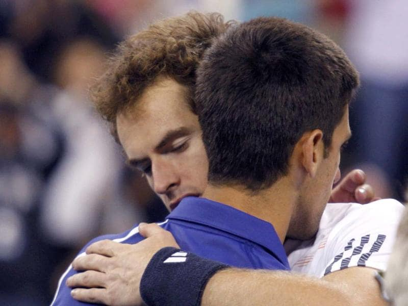 Britain's Andy Murray embraces Serbia's Novak Djokovic after defeating him in the men's singles final match at the US Open tennis tournament in New York. (Reuters/Eduardo Munoz)